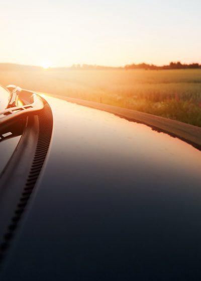 car sunset glossy